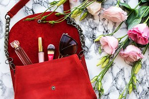 Red leather bag with accessories