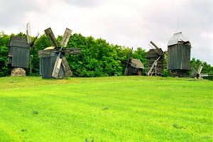 Wooden mills on the field of green g