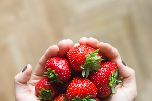 Lady holding fresh ripe strawberries