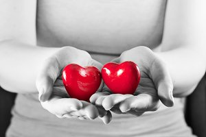 Two hearts in woman hands