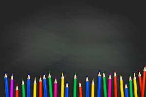 School pencils on blackboard