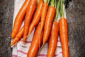 Carrots bunch on dark rustic wooden