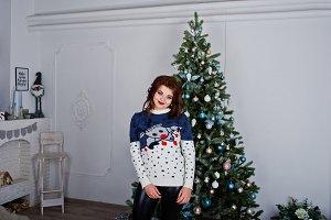 Girl wear warm sweater background ne