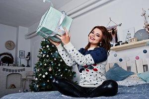 Girl wear warm sweater sitting on th