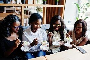 Four african american girls sitting