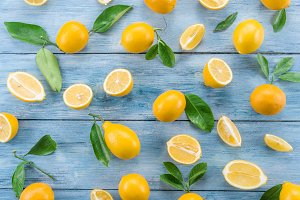 Ripe lemons on the blue wooden table