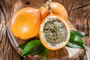 Granadilla fruits on the wooden tabl