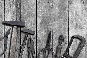 Old tools on wood background