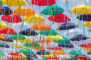 Colored umbrellas hanging above the