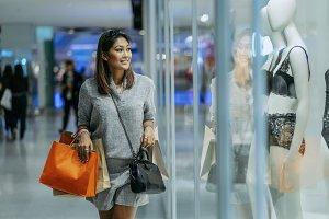 Happy Asian woman holding the shoppi