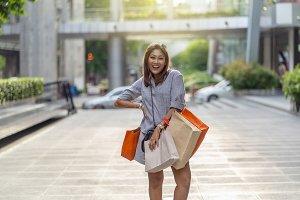 Portrait of Happy Asian woman walkin