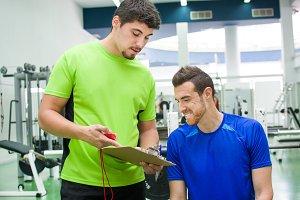 young man with personal trainer