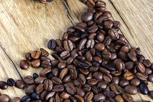 coffee beans on wooden background pi