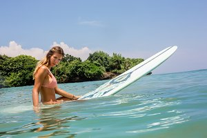 Sexy surfer girl with longboard surf