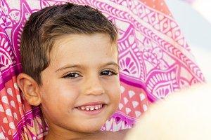 Adorable kid seated on a hammock
