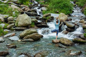 Woman in yoga asana Vrikshasana tree