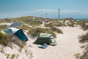 Camping tent on the beash sea coast.