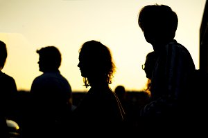 silhouette of group of friends walki