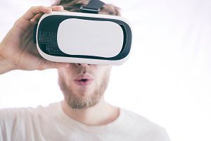 young emotional man using vr glasses