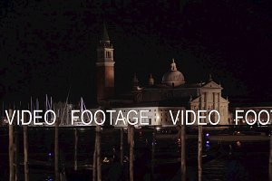 Night Venice with boats sailing