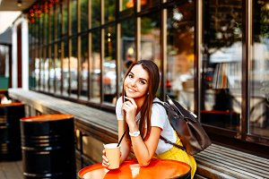 smiling girl in a summer cafe