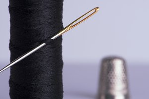 Thread with a needle and thimble
