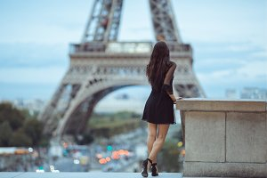 Parisian woman near the Eiffel tower
