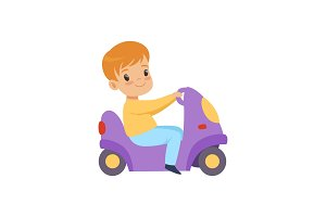 Cute little boy riding a toy