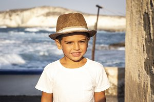 Portrait of a cute kid with hat