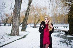 Elegance blonde girl in fur coat and