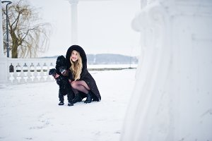 Elegance blonde girl in fur coat hug