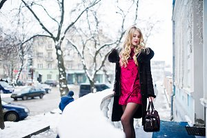 Elegance blonde girl in red evening