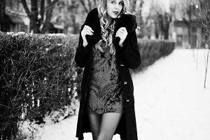 Elegance blonde girl in red evening