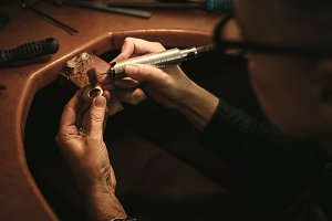 Jewelry designer polishing a ring
