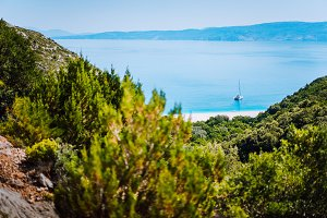 Lonely yacht on hidden Fteri beach