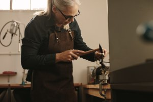 Senior jeweler shaping and designing