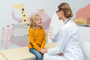 female doctor with little girl