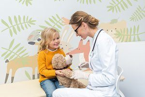 doctor doing injection for teddy bea