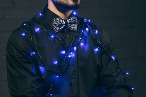 fashionable man with christmas light