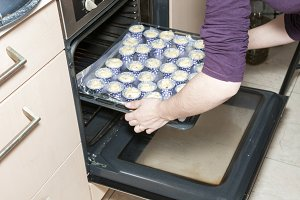 making muffins in the oven
