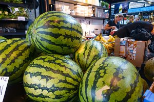 Purchasing watermelons in supermarke