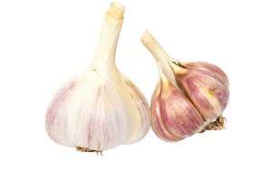 Two garlic cloves isolated on white.