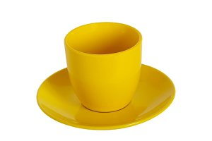 Yellow tea cup and saucer on white b