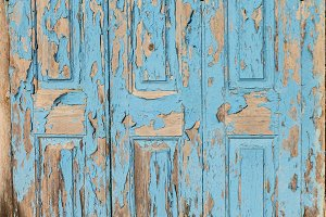 Old rusty blue door on a Greek islan