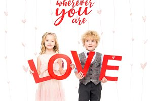 Kids holding word love