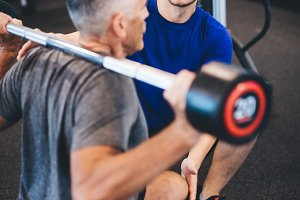Personal trainer and senior man exer