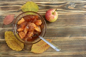 Apple jam in transparent plate