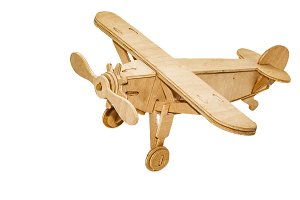 A yellow wooden toy souvenir plane