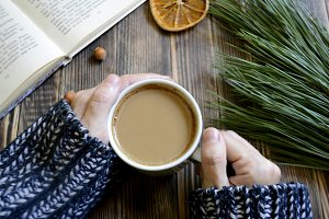 coffee cup in hand branch Christmas