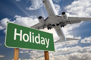 Holiday Green Road Sign and Airplane